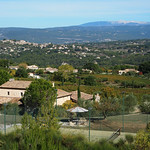 Looking over the vineyards of Chateau Edem to Goult village and Mont Ventoux